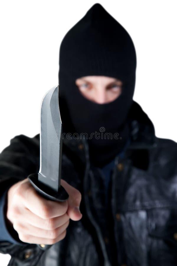 Junger Verbrecher mit Messer lizenzfreie stockfotografie