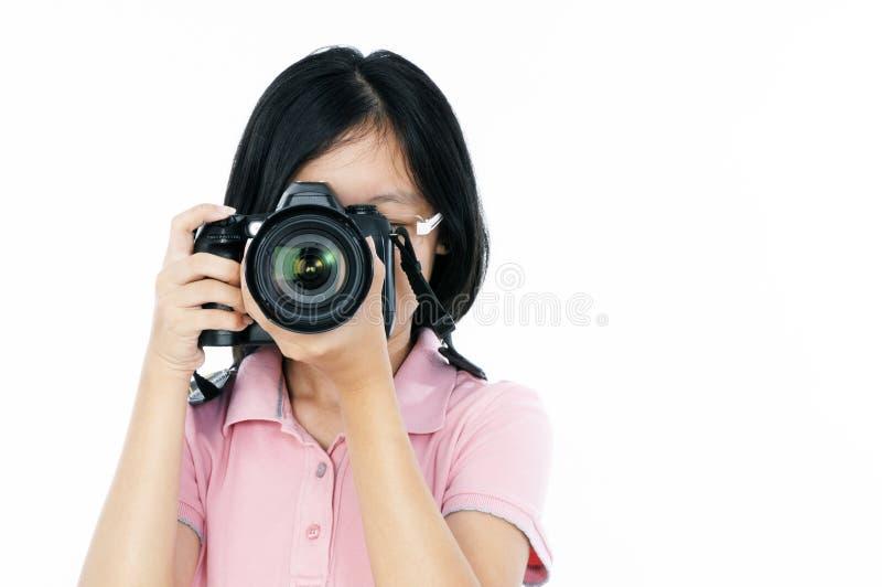 Junger weiblicher Fotograf lizenzfreies stockbild