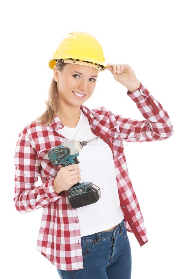 Junger zufälliger Frauenholdingbohrgerät- und -c$tragenschutzhelm. stockfotos