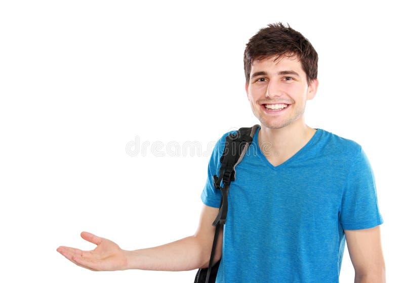 Junger zufälliger Mann, der etwas darstellt stockfotos