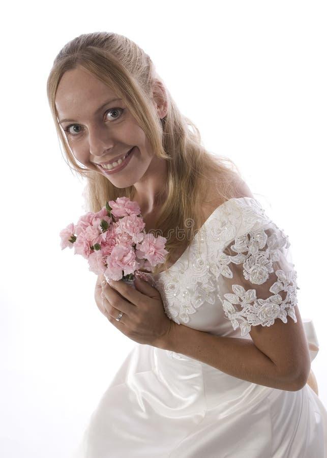 Junges blondes im Hochzeitskleid stockfoto