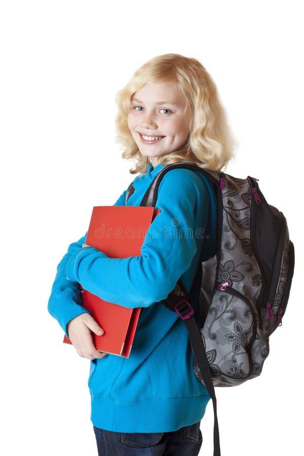Junges, blondes und prett Schulmädchen lächelt glücklich lizenzfreies stockfoto
