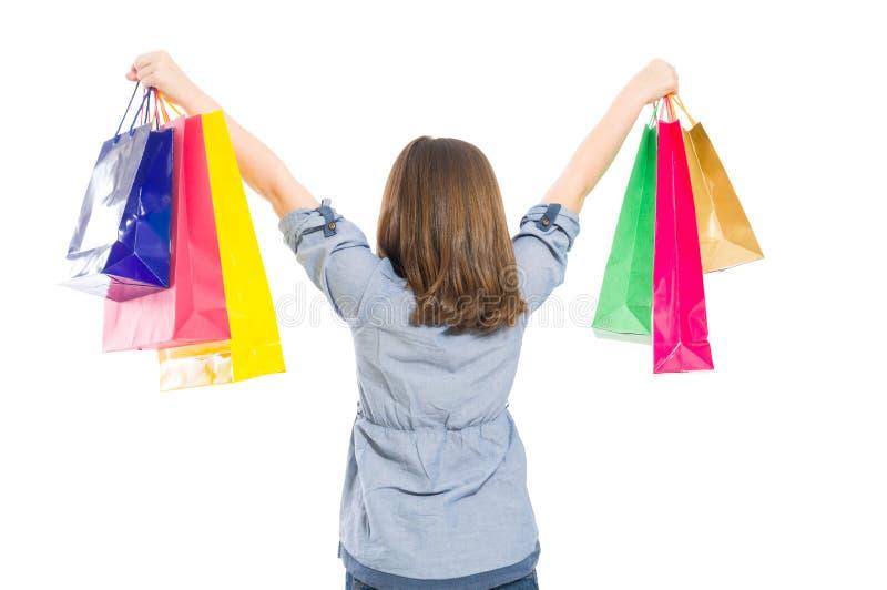 Junges Einkaufsmädchen von hinten stockbilder