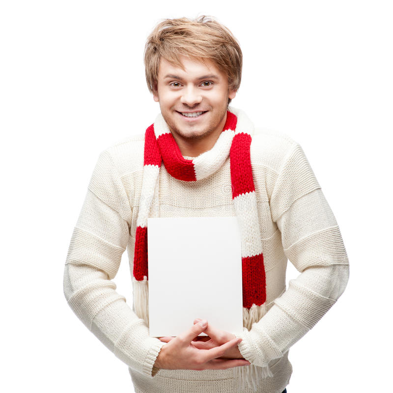 Junges freundliches glückliches Mannholdingzeichen lizenzfreies stockfoto