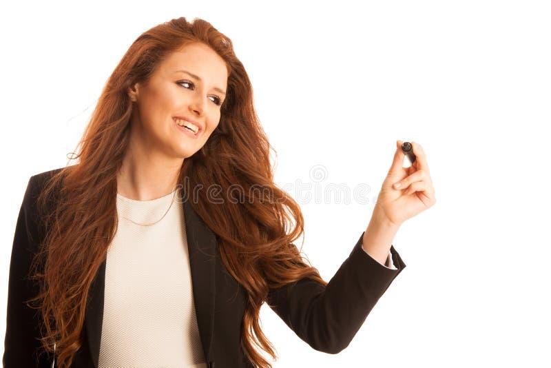 Junges Geschäftsfrauschreiben auf transparentem Brett gegen weißes b stockbild