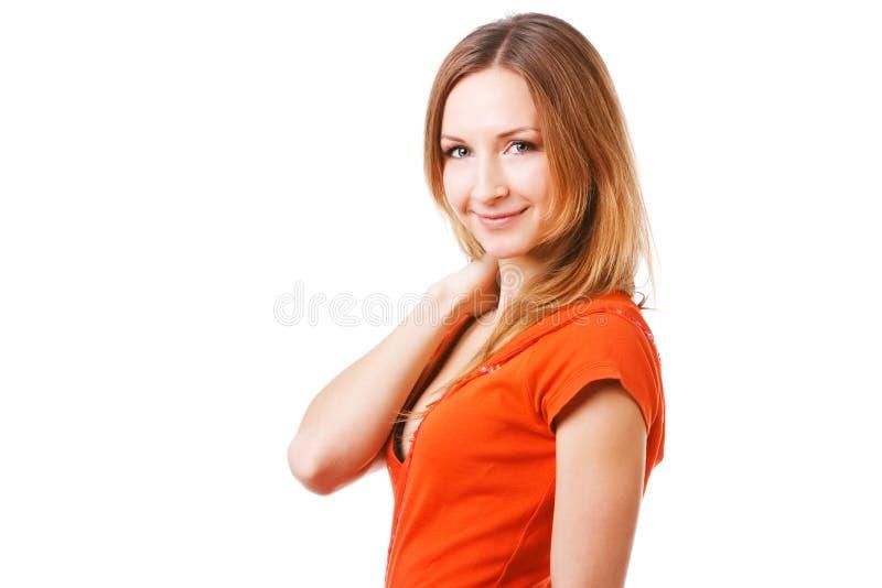 Junges hübsches Mädchen im orange Kleid stockfotografie