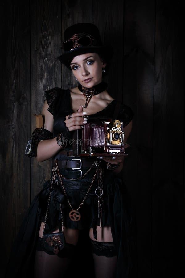 Junges hübsches Mädchen im Stil eines steampunk lizenzfreie stockfotos