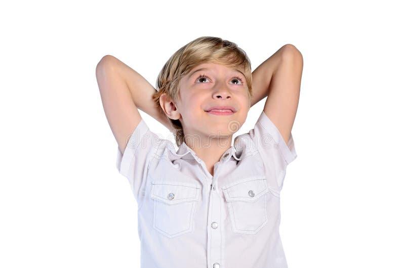 Junges Jungenträumen stockbild