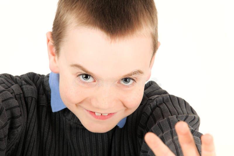Junges Jungenwellenartig bewegen lizenzfreie stockfotografie