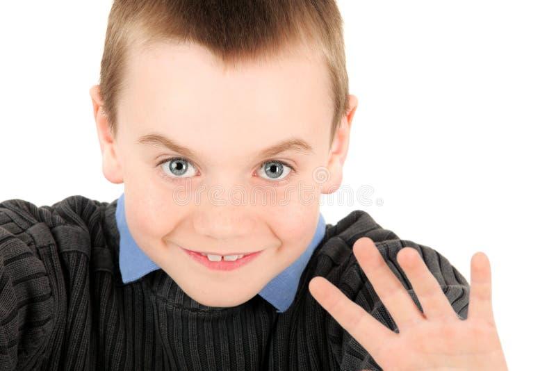 Junges Jungenwellenartig bewegen stockfotografie