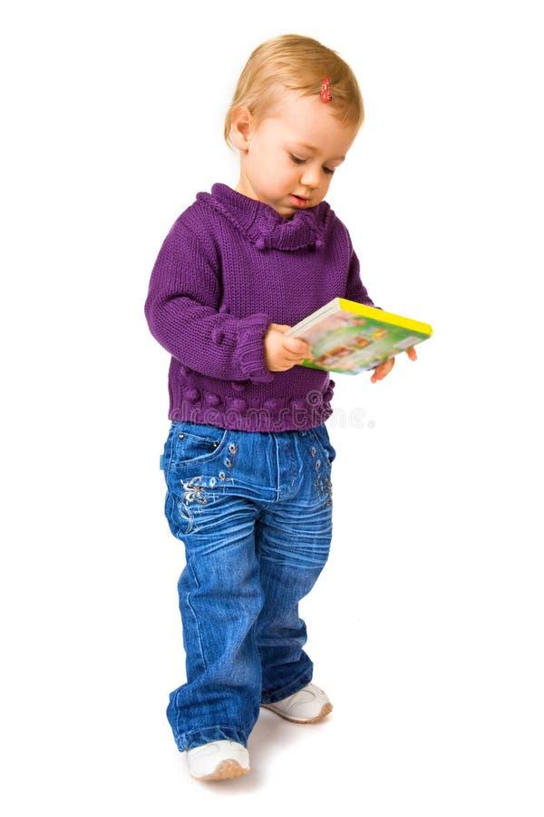 Junges Kind mit einem Buch stockbild