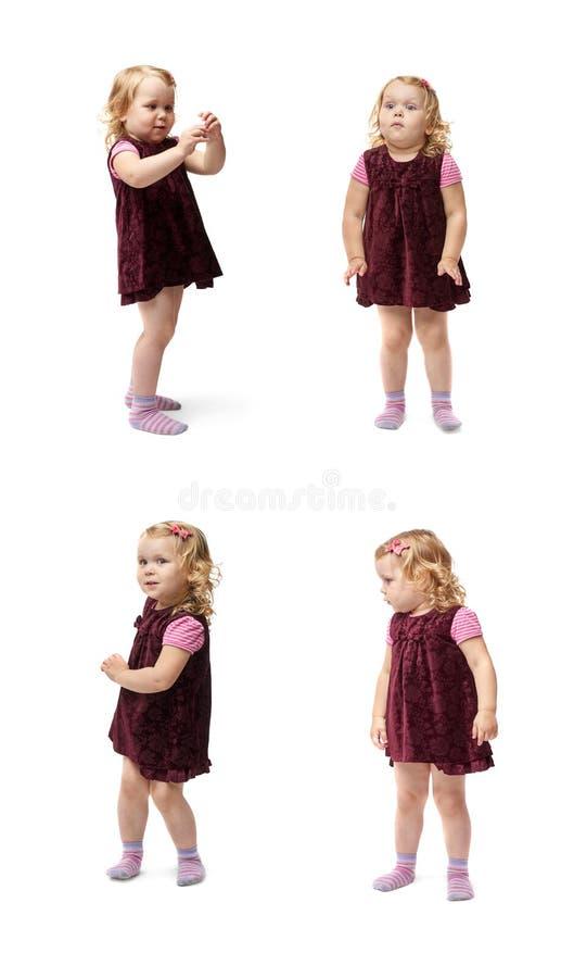Junges kleines Mädchen, das über lokalisiertem weißem Hintergrund steht stockbilder
