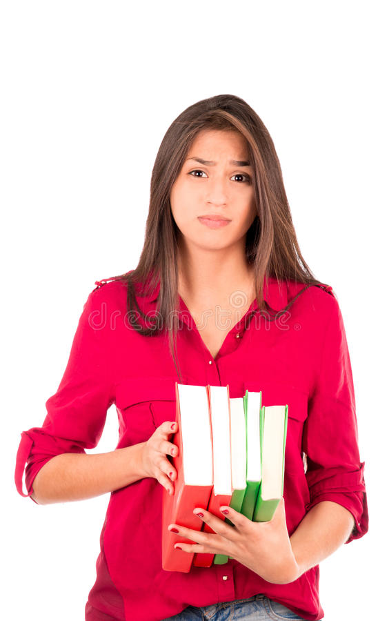 Junges lateinisches Mädchen, das Stapel von Büchern hält stockbilder