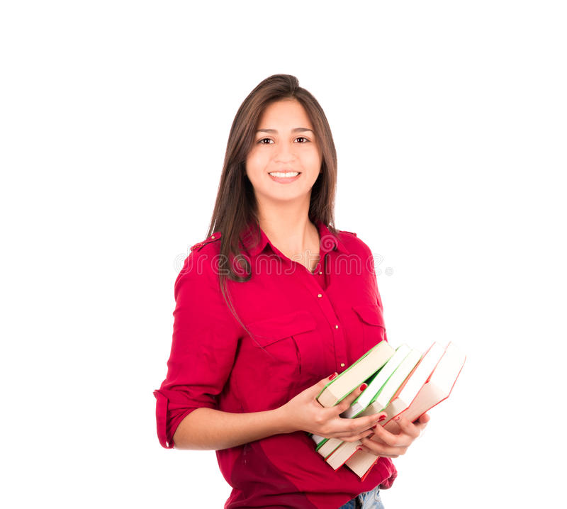 Junges lateinisches Mädchen, das Stapel von Büchern hält lizenzfreie stockfotos