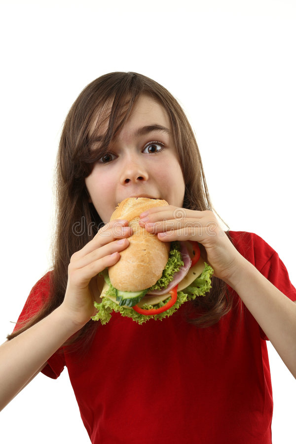 Junges Mädchen, das gesundes Sandwich isst stockfotos