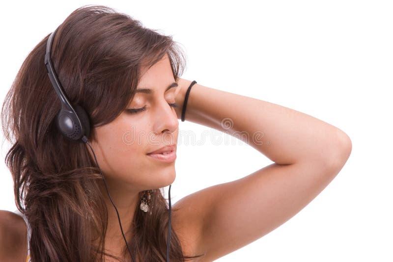 Junges Mädchen, das Musik hört stockbilder