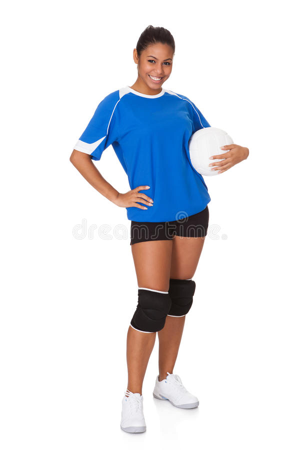 Junges Mädchen, das Volleyball anhält stockfotografie