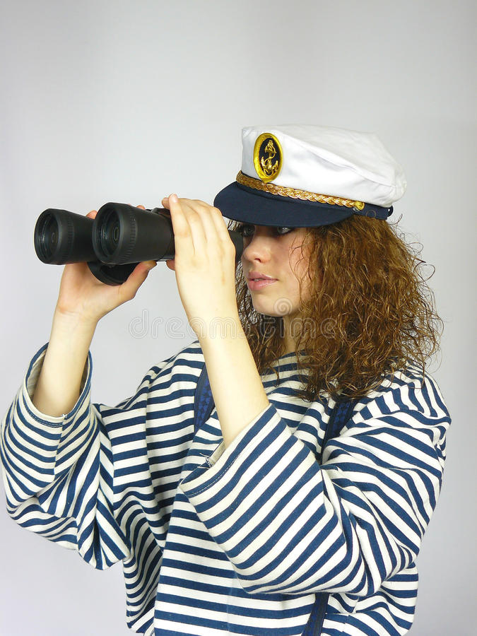 Junges Mädchen in der Schutzkappe eines Kapitäns lizenzfreie stockfotos