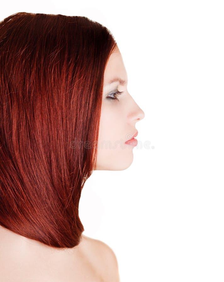 Junges Mädchen eingewickelt in ihrem Haar stockbilder