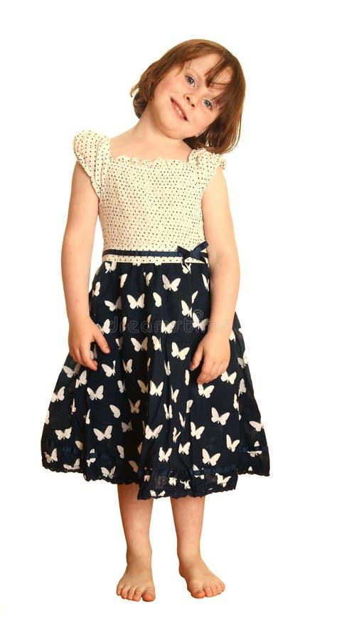 Junges Mädchen im Basisrecheneinheitskleid stockfoto