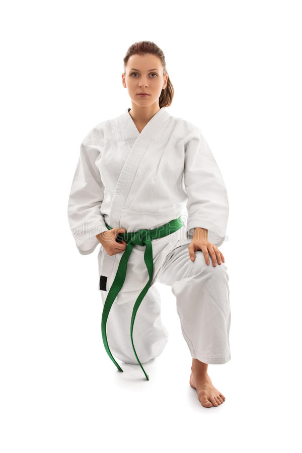 Junges Mädchen im Kimono auf ihrem Knie lizenzfreie stockfotos