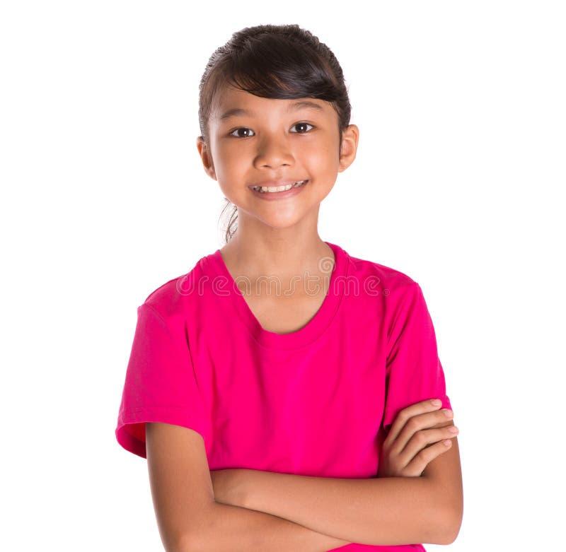 Junges Mädchen im rosa T-Shirt stockbild