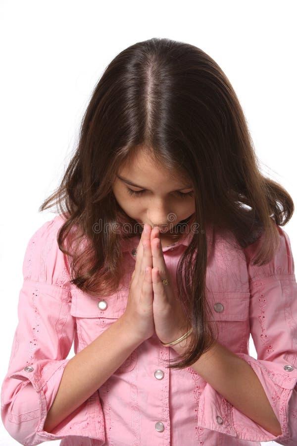 Junges Mädchen - Kopf gebeugt im Gebet lizenzfreie stockfotos