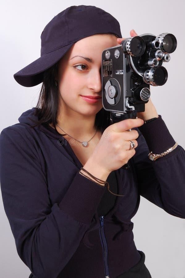 Junges Mädchen mit alter Kamera des Filmes (Film) lizenzfreie stockfotografie
