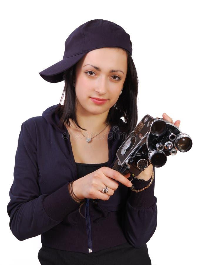 Junges Mädchen mit alter Kamera des Filmes (Film) stockfotos