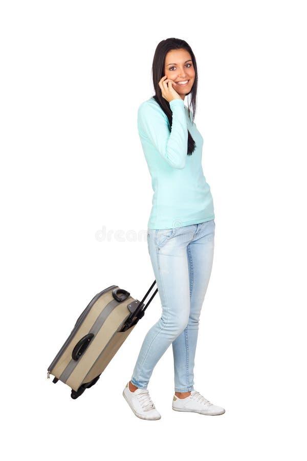 Junges Mädchen mit einem Reisen-Koffer lizenzfreie stockbilder