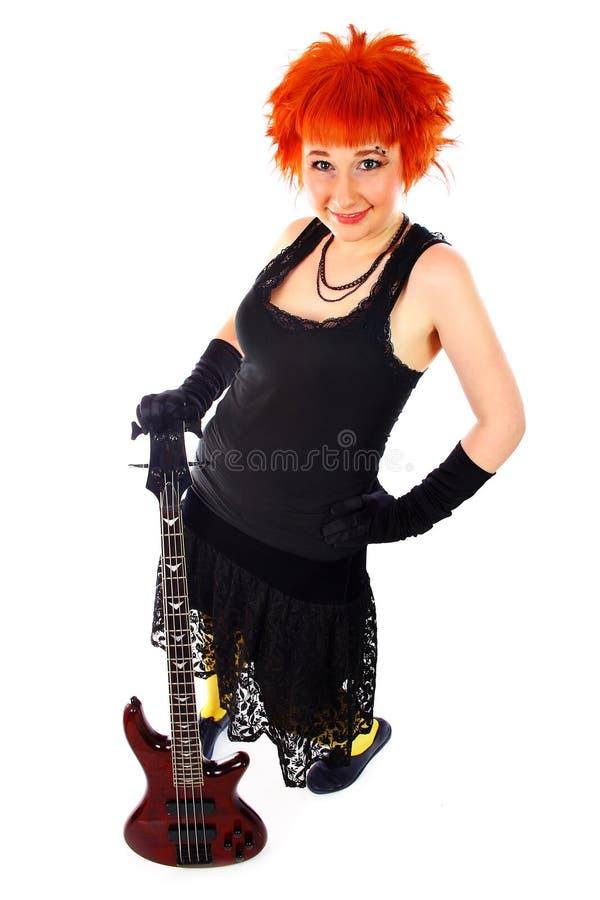 Junges Mädchen mit einer Gitarre lizenzfreies stockfoto