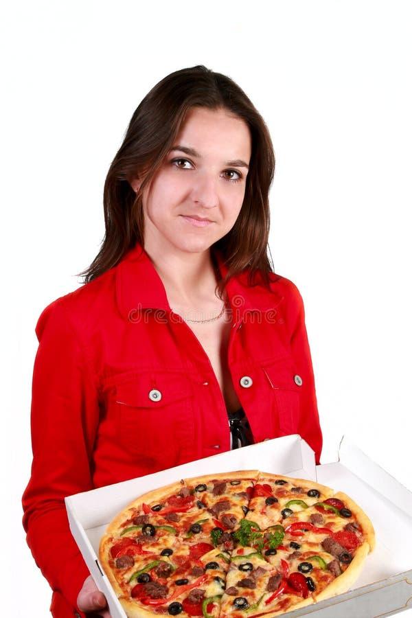 Junges Mädchen mit einer Pizza lizenzfreies stockbild