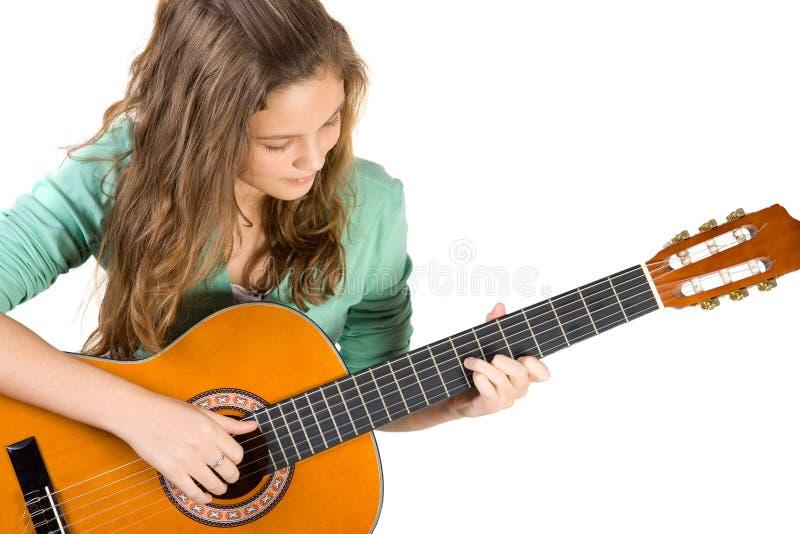Junges Mädchen mit Gitarre. stockbilder