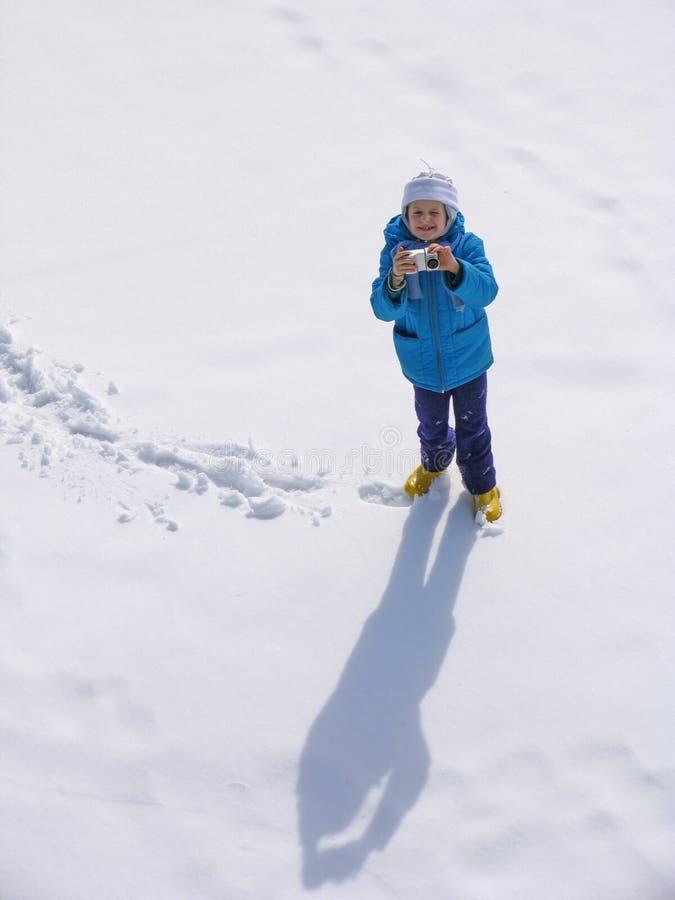 Junges Mädchen mit photocamera lizenzfreies stockfoto