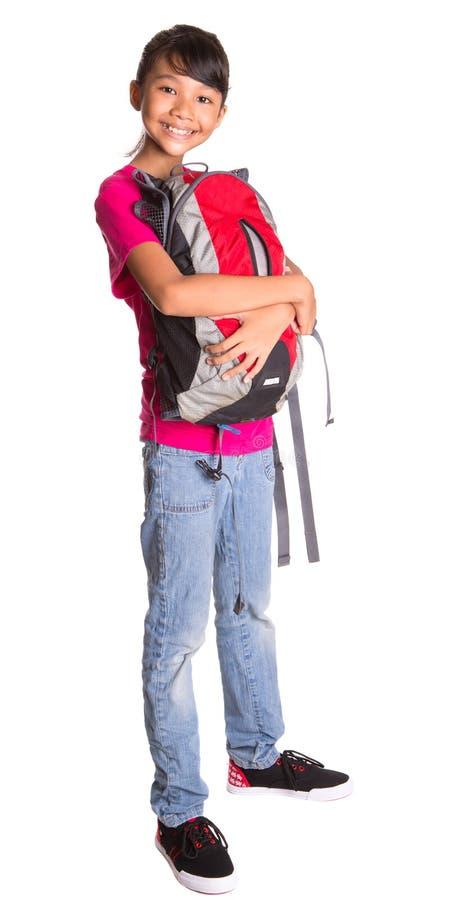 Junges Mädchen mit Rucksack X stockfoto