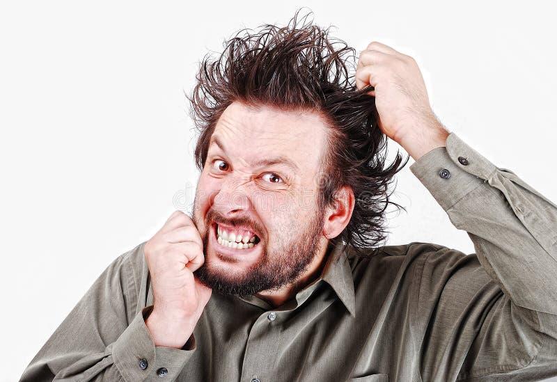 Junges männliches Baumuster mit dem lustigen Haar lizenzfreies stockbild