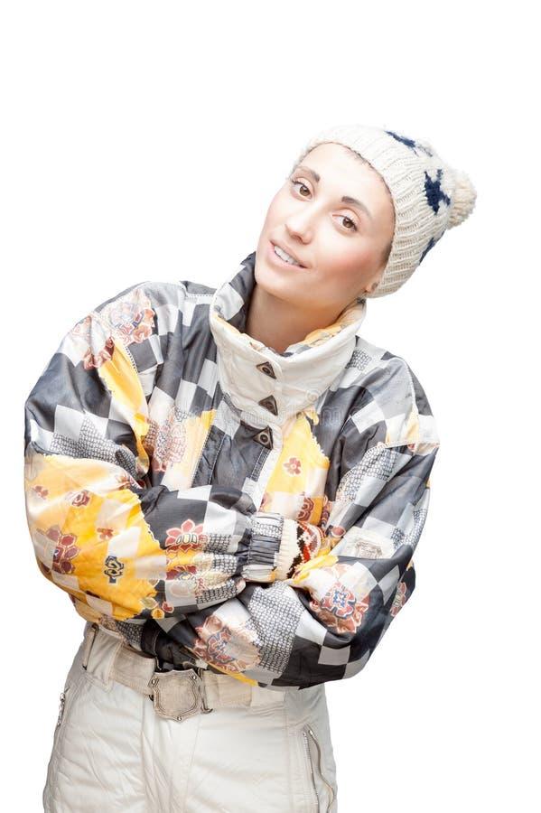 Junges nettes Mädchen im WinterSkianzug auf Weiß stockfoto