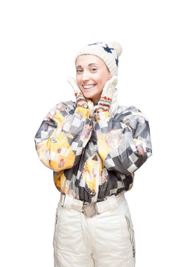 Junges nettes Mädchen im WinterSkianzug auf Weiß lizenzfreies stockfoto