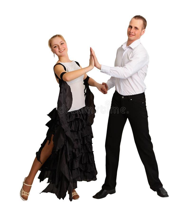 Junges Paar führt Ballsaaltanz durch stockfoto