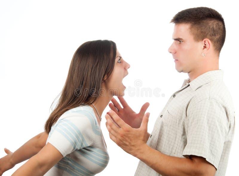 Junges Paarkämpfen getrennt auf Weiß stockfotos