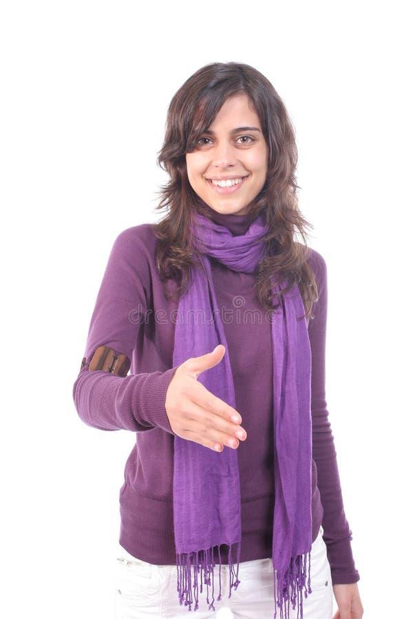 Junges schönes Mädchen, das anbietet, Hände zu rütteln lizenzfreie stockbilder