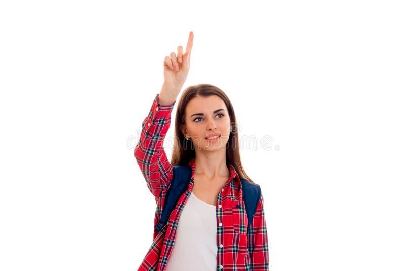 Junges Schönheitsstudentenmädchen mit der Rucksackaufstellung lokalisiert auf weißem Hintergrund im Studio stockfotografie