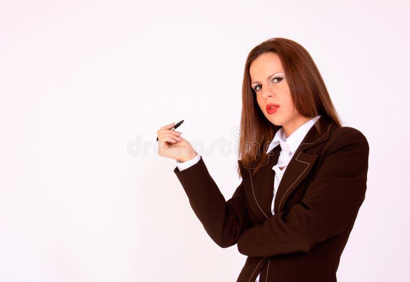 Junges Schulmädchen mit einer Feder in ihrer Hand lizenzfreie stockfotos