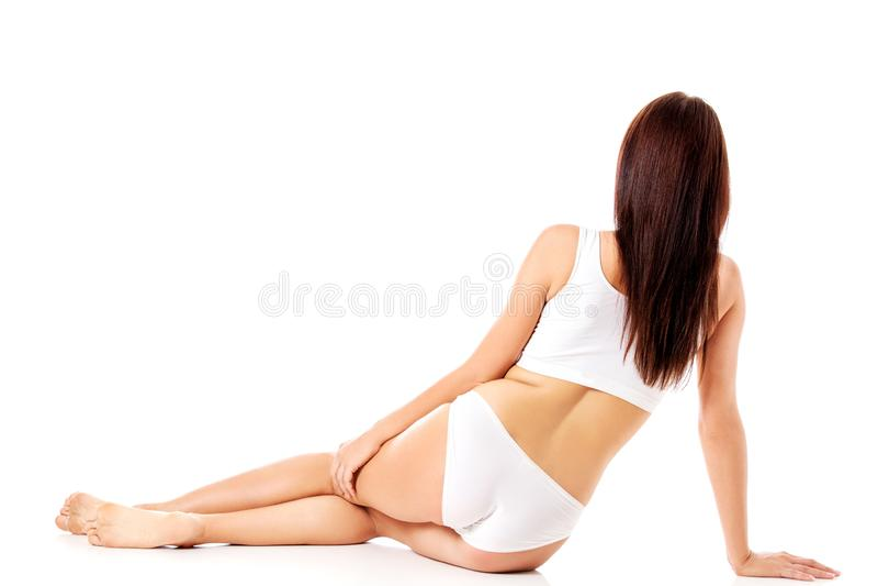 Junges, sportliches, geeignetes und schönes Mädchen in der sportlichen Unterwäsche lizenzfreies stockbild
