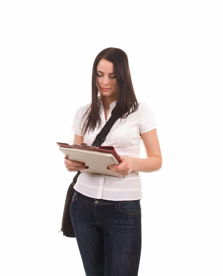 Junges Studentenmädchen (lokalisiert auf Weiß) stockfoto