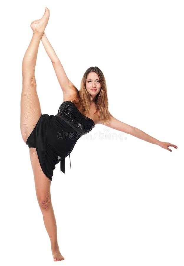 Junges Tänzermädchenausdehnen lizenzfreie stockbilder