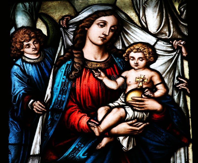 Jungfrau- Mariaholdingschätzchen Jesus stockbilder