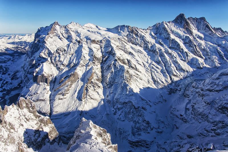 Jungfrau mountain wall in winter helicopter view stock images