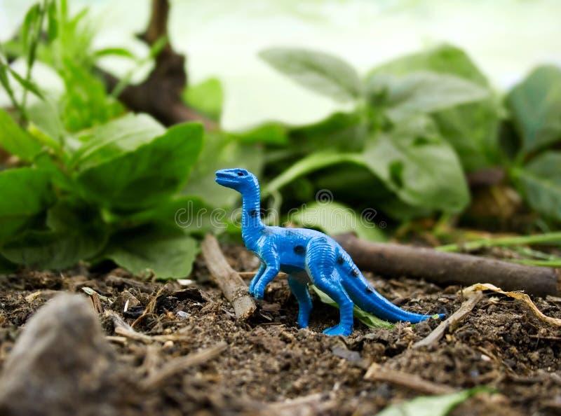 Jungle Blue Dinosaur. Standing on nature background stock image