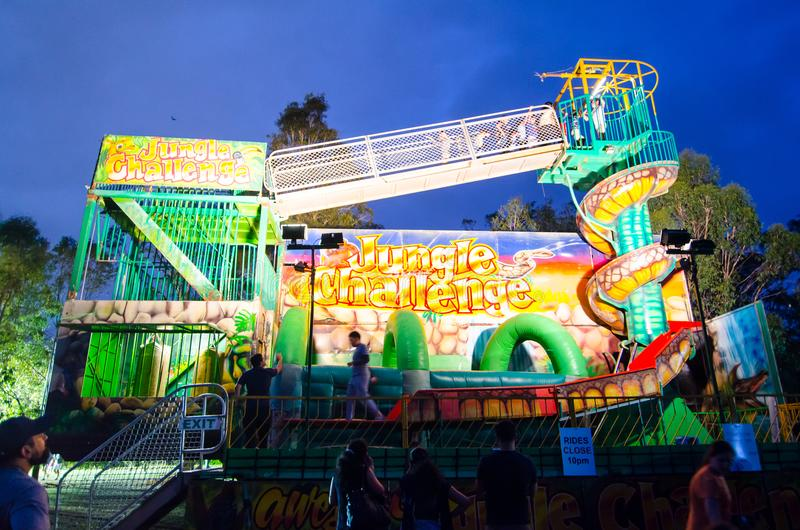 The Jungle Challenge carnival ride ride is filled with extreme slides, jumping castle and obstacle challenges. stock images